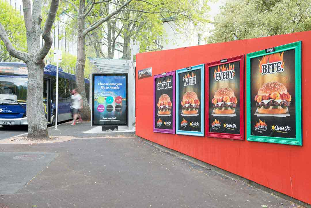 Vibrant Street Posters Next to Bus Stop Advertising